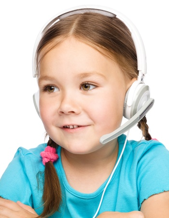 Cute young girl is working as an operator at helpline talking with customer using headset, isolated over white Stock Photo - 21089296