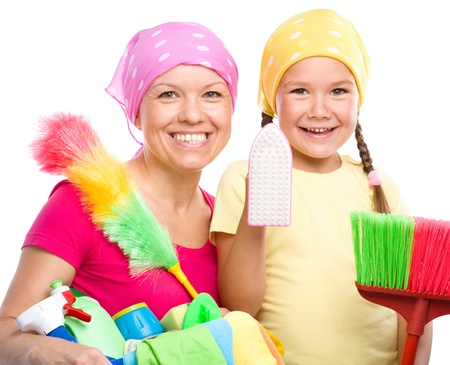 Happy mother and her daughter are dressed for cleaning, isolated over white photo