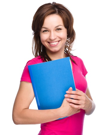 erudition: Young student girl is holding exercise book, isolated over white Stock Photo