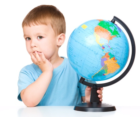 terrestrial: Little boy with a globe, isolated over white