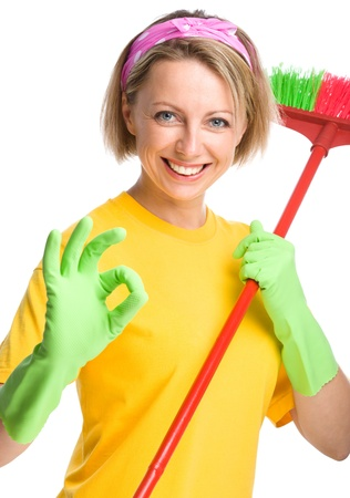 Young woman as a cleaning maid holding broom and showing OK sign, isolated over white Stock Photo - 21459041