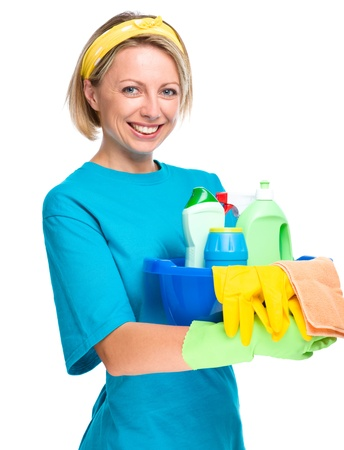housemaid: Young woman as a cleaning maid holding bucket full of liquids, isolated over white