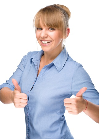 Young woman is showing thumb up gesture using both hands, isolated over white photo