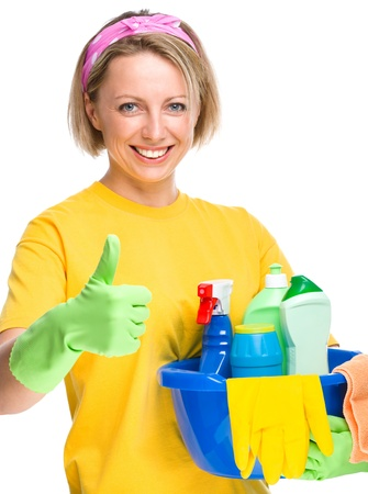 housewife gloves: Young woman as a cleaning maid holding bucket full of liquids and showing thumb up gesture, isolated over white Stock Photo