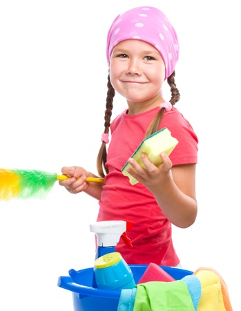 Young girl is dressed as a cleaning maid, holding static duster and sponge, isolated over white Stock Photo - 22160755