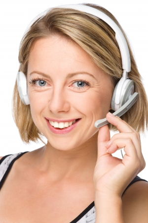 Closeup portrait of lovely young woman talking to customers as a consultant using headset, isolated over white Stock Photo - 22160756