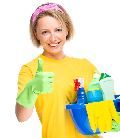 Young woman as a cleaning maid holding bucket full of liquids and showing thumb up gesture, isolated over white Stock Photo - 22448771