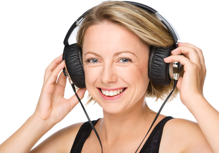 Closeup portrait of lovely young woman enjoying music using headphones, isolated over white photo