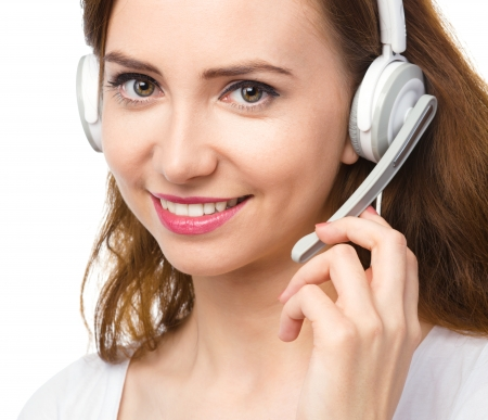 Closeup portrait of lovely young woman talking to customers as a consultant using headset, isolated over white Stock Photo - 22697671