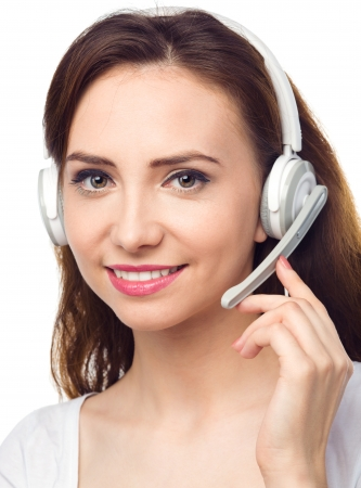 Closeup portrait of lovely young woman talking to customers as a consultant using headset, isolated over white Stock Photo - 23250926