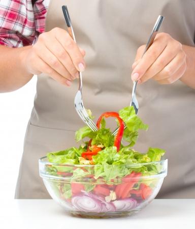 vegs: Cook is mixing fresh summer salad, closeup shoot