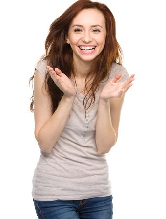 白で分離された幸せな若い女の肖像