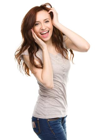 astonishment: Joven mujer es la celebraci�n de su cara de asombro, aislado m�s de blanco