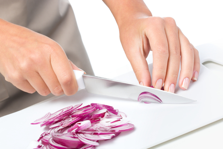chopping: Cook is chopping onion, closeup shoot Stock Photo