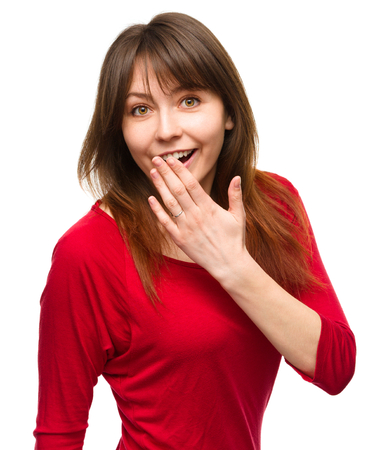 apprehension: Young woman is covering her mouth in astonishment, isolated over white Stock Photo