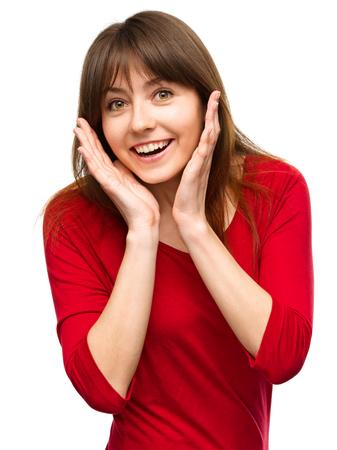 asombro: Joven mujer es la celebraci�n de su cara de asombro, aislado m�s de blanco