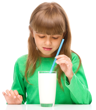 rejection sad: Gloomy little girl does not want to drink milk, isolated over white Stock Photo