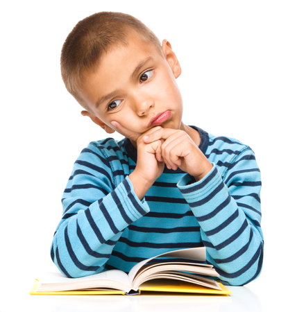 one little boy: Little boy is tired to read his book, isolated over white