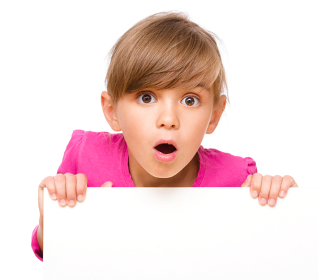 startled: Little girl is looking out from the blank banner, isolated over white Stock Photo