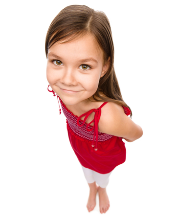 top angle view: Happy little girl in red dress, fisheye portrait, isolated over white