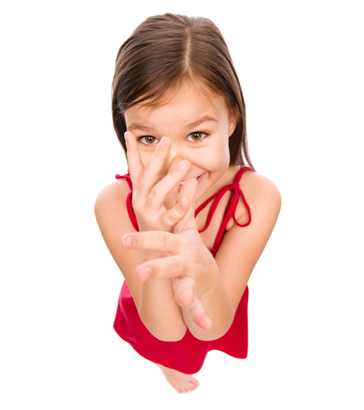 teasing: Little girl in red dress showing big nose, mocking, fisheye portrait, isolated over white