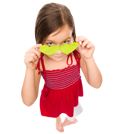 dubious: Little girl is looking over her heart-shaped glasses, fisheye portrait, valentine concept, isolated on white