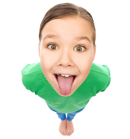 Funny little girl sticking her tongue out, fisheye portrait, isolated over white Banque d'images