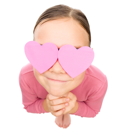 elated: Little girl with hearts over her eyes, fisheye portrait, valentine concept, isolated on white Stock Photo