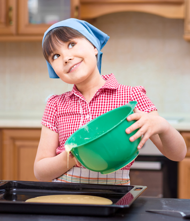 envision: Girl is cooking, thinking while looking up, indoor shoot