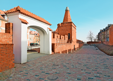 architectural exteriors: Old town wall and arc near Barbican, Warsaw city, Poland Stock Photo