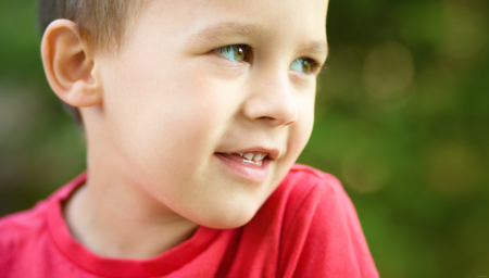 Close-up portrait of a cute little boy, outdoor shoot photo