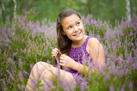 heather: Girl in heather flowers, outdoor shoot