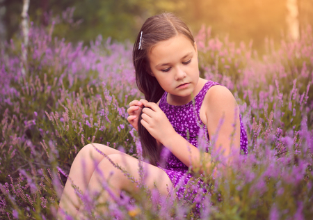 Girl in heather flowers, outdoor shoot photo