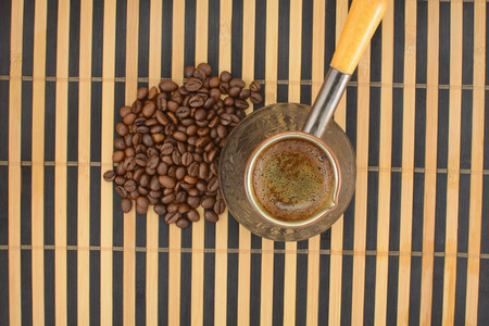 cheerfulness: coffee pot and coffee beans, striped background