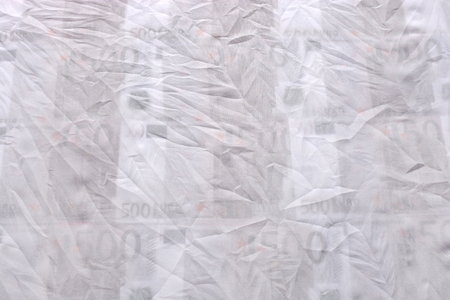 crumpled tissue: abstraction made ??of white crumpled tissue and euro money
