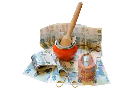 devaluation: the destruction of the Russian currency in a mortar and using scissors