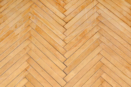 old wood floor: old and scratched parquet wood floor