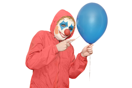pierce: Clown masked wants to pierce a balloon and scare