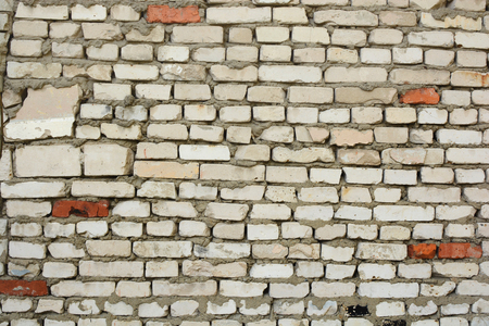 unevenly: background from old dirty brick crookedly folded