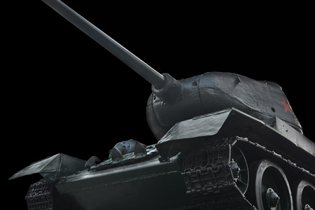 firepower: old Russian tank on a black background, view from below
