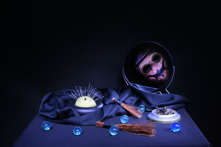 male killer: items for magic and witchcraft , exorcism ritual on a black background Stock Photo