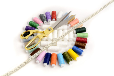 colored yarns to form a circle . measuring tape and scissors Stock Photo