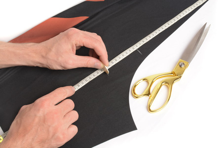 Taylor notes place the cut with the help of a measuring tape on fabric