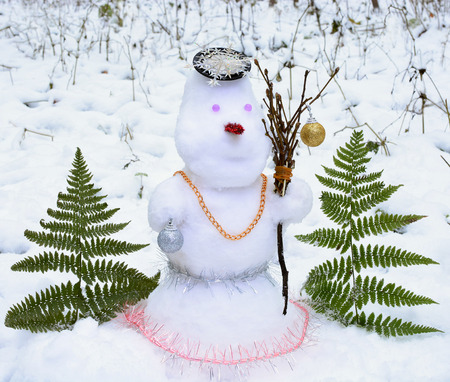 ball lump: Snowman in forest with Christmas decorations,  snowman made of white snow