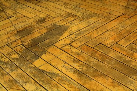 rundown: Flooring to repair, Dark brown wood background. Old parquet.