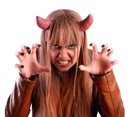 Girl frightens under the guise of the devil. Isolated on white background Stock Photo