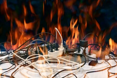 Concept of electrical short circuit. Electro wires on fire. Electric network overload, fire hazard Stock Photo