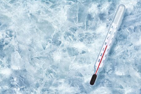 Concept of global cooling. Background from ice, cracks. Device for measuring temperature, Colds. Place for text