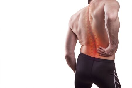 Damage to the lumbar back. A man holds his back in pain. Concept of human injury. Isolated on white background