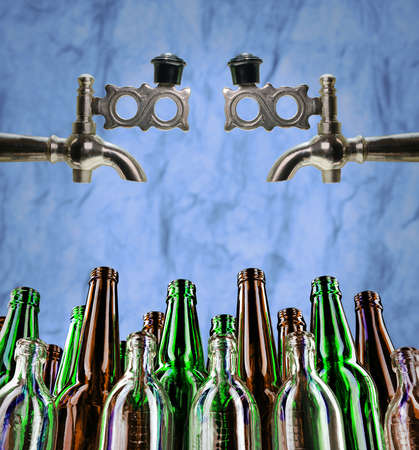 Clean bottles ready for spill from taps. Glass containers for various drinks. Concept